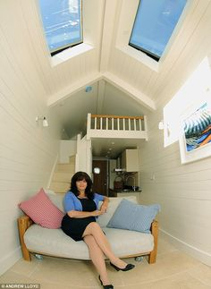 Cosy: The 23ft by 6ft beach hut can sleep four and has a fitted kitchen with granite worktops. Created by developer Bernard Howard in Shaldon, Devon, UK.