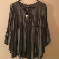 Free People Blouse Free People brand new gray blouse.   Size small.  Perfect over leggings or with jeans.  Super comfy.  Free People Tops