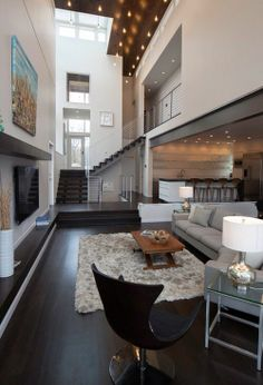 getting a feel for a narrow, tall space with a lot of playful elements like overlooks, interior windows, floating stairs, see through to outdoors....