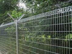 Two medium size deep circular stainless steel welded mesh baskets ...