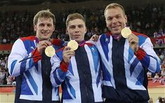 Great Britain's Jason Kenny Philip Hindes and Sir Chris Hoy celebrate with their gold medals
