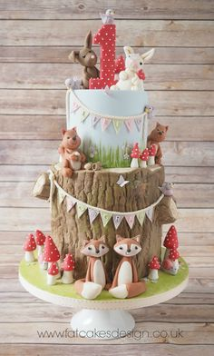 woodland animals first birthday cake
