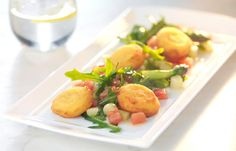 Sweet garlic galettes with a salad of asparagus and plum tomatoes