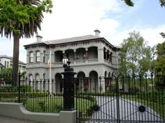 """Mandalay, Kew (Melbourne), is a beautifully restored Victorian Italianate mansion in the Melbourne suburb of Kew. Completed in 1892, architects being Beswicke & Coote. Originally known as """"Kaikoura"""", the building features a twin level verandah with both circular and elliptical arches, a square bay window as well as an impressive cast iron palisade fence."""