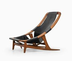 Nifty lounge chair designed by Arne Tidemand-Ruud. With adjustable seating positions this teak-framed chair, with leather upholstery, was produced by Norcraft of Norway in 1961.