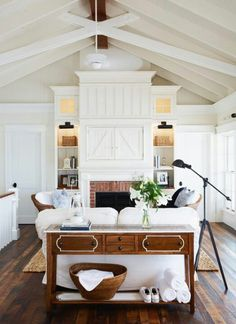 Like the varying elevations of the cabinetry.  Looks like sliding barn doors over media center.