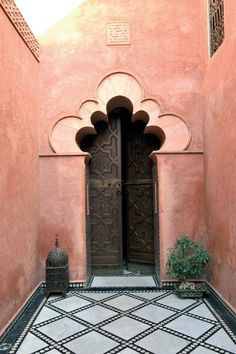 Magical archway opens onto a magnificent riad in Marrakech.