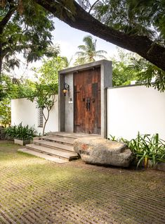 Modern Indian villas with courtyard designs. Featuring courtyard flooring, large reflection pool design, contemporary landscaping, plus luxury interior spaces. Entrance Design, House Entrance, Gate Design, Door Design, Exterior Design, Office Entrance, Courtyard Design, Courtyard House, Home With Courtyard