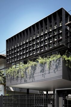 A Bangkok House with a Steel Facade Filled with Plants by Anonym - Design Milk