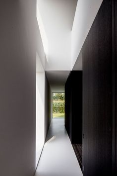 Dark wood and white walls and floors; sublime. Barn renovation by Belgium architect Pascal Francois.