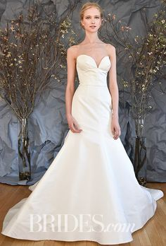 "Brides.com: . ""Sonata,"" Style AS90, silk radzmir fully fared gown with plunging neckline and tailored a-line skirt, Austin Scarlett"