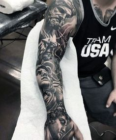 106 Insanely Hot Tattoos For Men Imposing Greek Gods tattoo. Angel Sleeve Tattoo, Full Sleeve Tattoos, Tattoo Sleeve Designs, Tattoo Designs Men, Tattoo Sleeves, Black Sleeve Tattoo, Angel Tattoo Men, Cool Tattoos For Guys, Trendy Tattoos