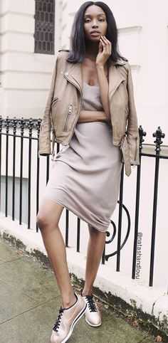 A slip dress layered under a leather jacket and paired with sneakers. Slip Dress Outfit, Slip Dresses, Dress Outfits, Fashion Outfits, Sneakers Fashion, Converse Sneakers, Dress Fashion, 90s Fashion, Street Fashion