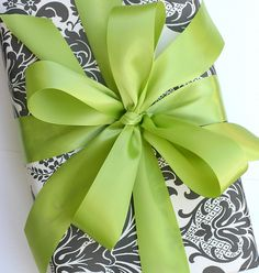 Detailed black and white wrapping with bright bow makes a stunning statement.
