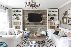 Wood pallet wall for the farmhouse style living room.
