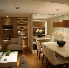 A iluminação é uma excelente opção para dar valor aos objetivos na decoração. #casacasual #dica