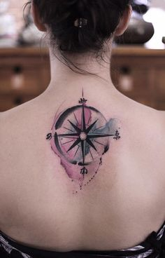 Beautiful watercolor compass back tattoo - 50+ Awesome Compass Tattoo Designs