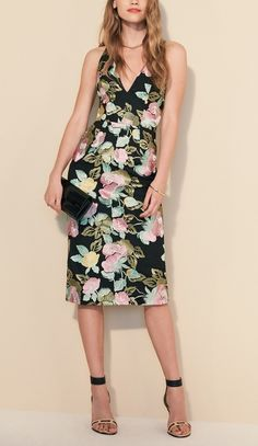 Decadent floral embroidery illuminates the contemporary silhouette of this figure-tracing cocktail dress.
