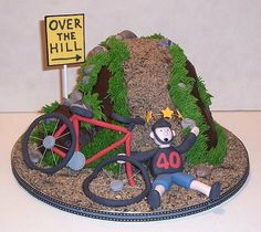 """Over The Hill Bike Wreck Cake made for a cycling enthusiast who is turning The biker and his bike have crashed just as they head """". Bicycle Cake, Bike Cakes, Bicycle Shop, Birthday Cakes For Men, Man Birthday, Marzipan, Mountain Bike Cake, Over The Hill Cakes, Motorbike Cake"""