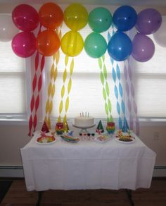 decorating with streamers | The Display Table with Rainbow Balloons and Rainbow Streamers