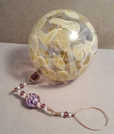 Pixie Fairy Orb / Witch Ball, Hand Blown Glass, Hanging Ornament, Purple Ribbon Cane Bead by AspenHotGlass on Etsy