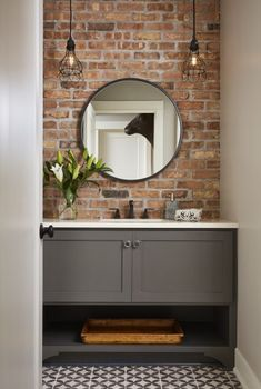 Exposed brick wall in bathroom