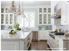 This is the look for my new kitchen.. dark floors, white cabinets and watery blue backsplash tiles.  I will have a quartz countertop on the island and darker charcoal-coloured countertops throughout.