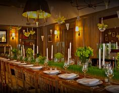 I like the grass centerpiece and natural wood combo against the white china