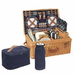 """Woven willow picnic basket with a navy corduroy lining and matching serveware.     Product:  1 Wine cooler bag  1 Blanket 4 Wine glasses 2 Food containers 1 Salt and 1 pepper shaker 4 Mugs 4 Plates4 Sets of utensils 1 Bottle stopper1 Cheese knife 1 Cutting board  1 Corkscrew  4 Napkins  1 Vacuum flask 1 Picnic basket      Construction Material:  Corduroy, fleece, plastic, stainless steel, porcelain, wood, willow, leather and cotton Color: Natural and navy      Dimensions: 14.5""""H x 24"""" ..."""