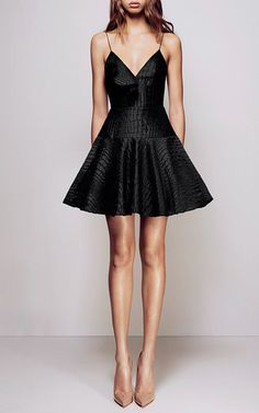This **Alex Perry** dress features a deep-v neckline and allover silk reptile print with a flared mini silhouette.