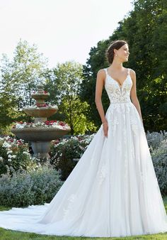 Wedding dress style 5805 by Mori Lee. The Sparrow wedding dress features crystal and pearl beaded, embroidered lace appliqués on a soft net A-line silhouette with satin waistband. Available with front bodice lining as style Bridal Wedding Dresses, Wedding Dress Styles, Dream Wedding Dresses, Wedding Outfits, Wedding Dress Sheath, Mori Lee Wedding Dress, Pronovias Wedding Dress, Wedding Dress Pictures, Bridesmaid Dresses