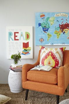 Book-nook corner how to: Start with a rug and chair. Add coordinating wall art and a pillow to bring it all together!