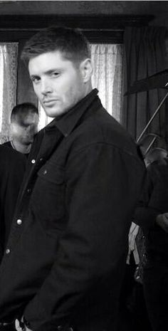 Jensen, between the scenes, but staying in character. (Can we talk about the guy in the background with the creepy face???)