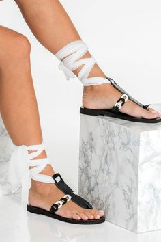 Ermioni design gladiator sandals are handcrafted with premium quality black leather and detailed with our chain strap in black and white. Unique and feminine will upgrade your summer closet instantly. The flats fasten easily and safely yet ultra stylish with our signature silk laces that come in 15 colors. They are great for grounding your formal summer outfit. Greek Chic Handmades flat sandals are designed and handcrafted in Athens, Greece from premium leather and luxurious fabrics. Gladiator Sandals, Ankle Wrap Sandals, Greek Sandals, T Strap Sandals, Lace Up Sandals, Black Leather Sandals, Leather And Lace, Calf Leather, Summer Shoes