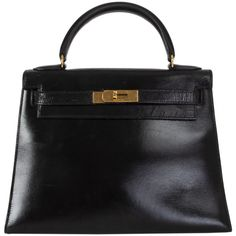 View this item and discover similar for sale at - Hermes 'Kelly l 28 Sellier' bag in black Veau Box leather. Vintage Lined in leather with two open pockets against the front and an open pocket against Studded Handbags, Quilted Handbags, Black Handbags, Bvlgari Tote, Chanel Quilted Handbag, Celine Mini Luggage, Hermes Kelly Bag, Large Shoulder Bags, Black Box