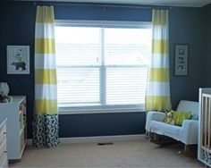 navy yellow nursery with cute striped curtains