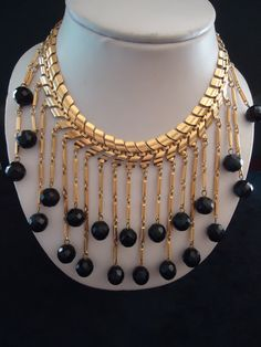 Love this necklace. Great look. This is a waterfall style necklace set on gold tone metal. The round crystals are prong set. 17 long. The bib