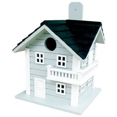 Cottage-style birdhouse with a cedar shingle roof.      Product: Birdhouse Construction Material: Plywood and wood...