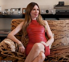 Carole Radziwill today at her Manhattan apartment (in fierce lipstick red leather dress!)