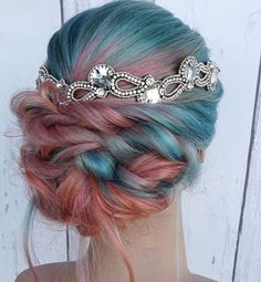 Teal and red orange ombré hair color with hair accessory