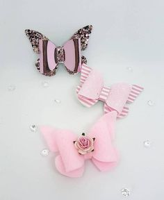 ♥ Set of 3 really cute Handmade glitter butterfly Hair Clips♥ This set of clips feature 1 pink stripped leatherette and pink glitter butterfly clip, 1 pink mirrored and glitter butterfly clip and a cute soft pink gelt butterfly with a flower embellishment. All attached to an alligator