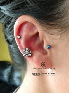 Lani had a two year old conch (not done by us) in need of something fancy. She chose this stunning anatometal captive cluster with seven Swarovski CZ's. Thank you so much Lani!