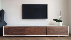 long sideboard can accomodate soundbar http://www.prettylittlegreenthings.com/wp-content/uploads/2011/04/Charlet-Design-sideboard.jpg
