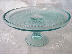 """Harp"" pattern cake plate in ice blue, by Jeannette Glass Company 1950's."