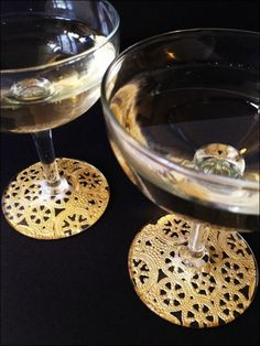 Make gilded lace champagne glasses (via dollarstorecrafts.com) (i like the idea of these for other glassware - the bottom of a square vase, or the sides of a wide candle holder) Anything with a flat glass bottom, I suppose.