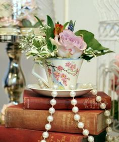 more decor ideas....grandmas teacups, pearls and old books