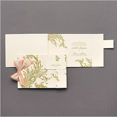 Couture luxury wedding invitations that are lavish, beribboned, and adorned with gold and pink flourishes to tell your love story in the stylish manner it deserves.  Open version to show just how fabulous it is.