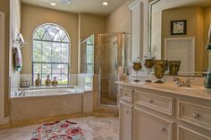 Traditional Master Bathroom with Flat panel cabinets, High ceiling, complex granite tile floors, Undermount sink, Limestone