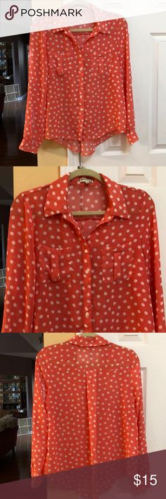 """Button down Blouse, orange with white dots. Large Button down Orange Blouse with white polka dots. Large. Excellent condition. Armpit/bust measures about 21"""", and length is about 24"""". Polyester. Chocolate Tops Button Down Shirts"""