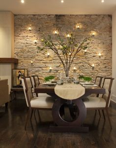Stone wall in dining room...love it!  Keeping the color variation of the stone to a minimum helps keep the contemporary vibe to the space. Also, keeping the stone size relatively similar helps with that as well.